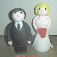 Wedding Couple Hello,here is my attempt to create a wedding couple completly made of sugarpaste.Do you like it ?greetz Eros