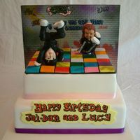 Breakdancing Dancefloor Cake This cake was a challenge, I made the two breakdancer toppers ages ago and both topper had a cake dowel through them sticking out, one...