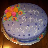 Birthday Cake For Grandma This cake was a lot of fun to make! My first time working with flowers and gum paste. Some lessons learned, but not too bad over all.