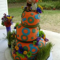 Orange Cake W/circles My first crazy cake. This bride was so fun. She even had pink hair for her wedding!