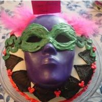 "Mask Cake This cake was for my 12 year old sister's party today. She wanted to have a ""masquerade."" The mask is colored candy melts-..."