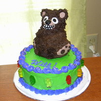 "Bear Cake Quickie I made for my husband's Bday. Mini-stand up bear pan on top of 6"" round. Those are gummi bears around the sides."