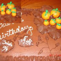 Harvest Cake I This cake was made for the October birthdays of my co-workers. The cake is chocolate with chocolate BC icing. The pumpkins are MMF and the...