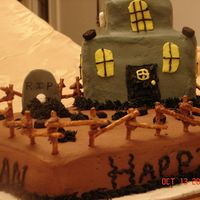 Haunted Birthday House This is a halloween themed birthday cake. The cake is chocolate and the house is yellow cake. The cake is decorated with BC.
