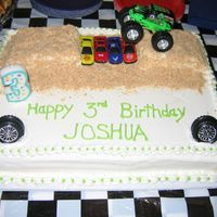 Pic479.jpg Vanilla cake with BC icing. The ramps for the monster truck are actually Little Debbie cakes covered in Nilla wafers.