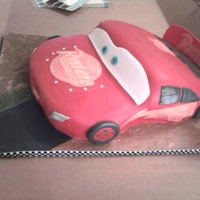 Lightening Mcqueen/cars Yellow cake with buttercream and covered in fondant.