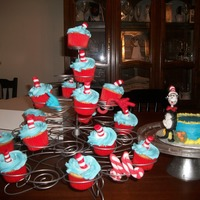 Dr. Seuss 1St Birthday Cupcakes & Smash cake....yellow cake covered in buttercream with gumpaste accents.