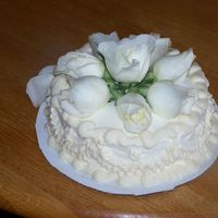 Engaged white cake,peaches and cream filling and whip cream frosting.Real flowers on top .