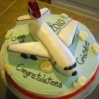 Airplane Graduation Cake carved the plane. The tail is rice krispy treats.