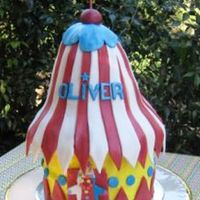 Circus Tent Cake 1st Birthday Cake - Circus Tent - Clown. bottom Chocolate mudcake, tent top rkt's, buttercream icing, fondant decos.