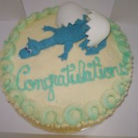 Hatching Baby Dragon Vanilla cake with raspberry filling and Buttercream Frosting. Gumpaste/Fondant Dragon and Egg.