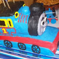 Thomas Cake First attempt with sculpting a cake. It was for a friend's son's birthday. There were 3 of us working on it & it was such a...