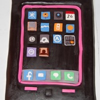 Iphone My daughter n laws birthday cake , DH cake mix , covered in satin ice black and the rest is mmf .
