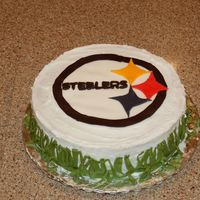 Pittsburg Steelers My 13 year old daughter made this cake for her teacher using a fondant logo on a buttercreme frosted cake. She printed the logo from the...
