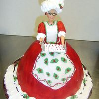 Mrs. Claus 3 A customer saw my previous cake and order one. The dress is made of buttercream icing and the apron is fondant.