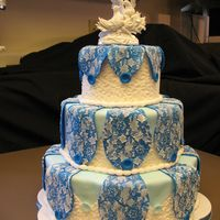 Img_1048.jpg Brocade Elegance3-tier petal cake, buttercream icing with cornelli lace, edible fondant buttons and pearls, brocade panels are fondant,...