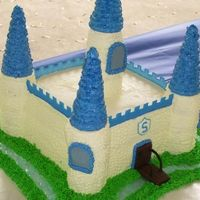 "Castle Cake  The mom didn't want a ""war"" castle cake. She wanted a ""prince"" cake. It is 8"" with cupcakes as the towers,..."