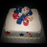 Labor Day Weekend / Birthday Cake Coconut cream cake iced in marshmallow buttercream. Bow and decorations from MMF.