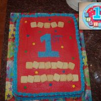 Johnathan's First Birthday Vanilla cake with buttercream frosting and Earth's Best Alphabet Block cookies. It's hard to see, but the blocks spell out HAPPY...