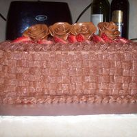 First Basket Weave Vanilla cake with choc buttercream sliced strwberries and tootsie roll roses. This was for my brother & sister-in-law visiting us in MA...