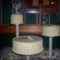 Basket Weave My first wedding cake! I didn't like the flowers, but it was what the bride wanted.
