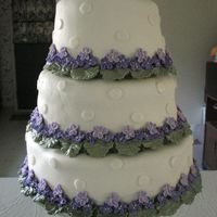 Violet Cake for a friends small outdoor wedding. She wanted purple flowers and ivory icing. MMF and violets fit her specifications perfectly.