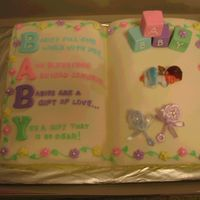 Baby Shower Cake Cake from 2006 Wilton's Book. Blocks out of fondant since I couldn't find any to purchase. Baby borrowed from a dear friend who...