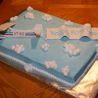 Aaron's 80Th Birthday Cake 80th Birthday cake for a pilot instructor. 1/2 WASC and 1/2 Darn Good Chocolate Cake.Airplane & Banner made of fondant/gumpaste.My cute...