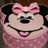 "Kaylee's 4Th Birthday Minnie Mouse birthday cake for my grand-daughter's 4th birthday. 10"" round with 6"" ears. Fondant face and accents. Thanks to..."