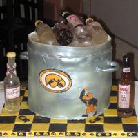 Beer Bucket   Beer bottles and ice are made of sugar, the rest is cake. Each tier was different flavor with different filling, TFL