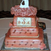 Terracotta Wedding Cake All tiers different flavors with different fillings, covered in MMF with accents. Roses made of gumpaste. TFL