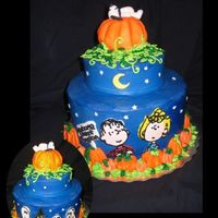 "The Great Pumpkin 2 layer 9"" and 1 layer 6"" covered and decorated with BCThe Pumpkin on top is RKT covered with fondant and a fondant Snoopy."