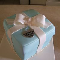 Tiffany Shower Cake I did this for a friends sisters Bridal Shower. This is 3 2 inch layers stacked and covered in MMF with gumpaste bow and gumpaste heart tag...