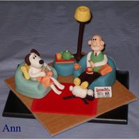 Wallace And Gromit Model made of marzipan and sugarpaste. Entirely edible with the exceptions of the knitting needles and the post of the lamp. Based on a...
