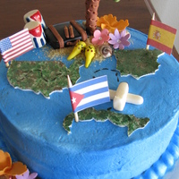 Cuba,spain & Usa A cake showing a womans journey from Cuba to Spain then making a life in the USA.