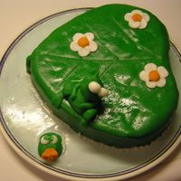 Frog On A Leaf In Water Cake frogs made in milk paste