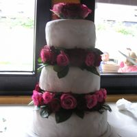 Red Rose Wedding Cake for my mom's birthdaymy FIRST WEDDING CAKE EVER! Sugarpaste is homemade - as allways and it crackled but it's my first so... i...