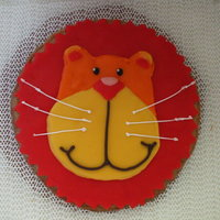 Lion Face I was commissioned to make this for the top of a cake..it had a cookie base and then RI..kinda like coloring in a coloring book..took a few...