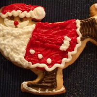 Skating Santa I saw this in a book..and had to try it! Buttercream icing and sugar cookie..Happy Icing!