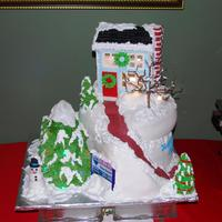 Holiday Birthday Cake Created for a realtor for his holiday birthday. The house and large tree were lit with battery operated lights. Ten and 14 inch white cakes...