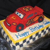 Disney's Lightening Mcqueen! This was inspired by another photo on this site! Thank you! This was a huge hit! All buttercream, Wilton cruiser pan for the car.