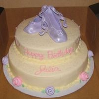 Ballet Cake The cakes are frosted with buttercream, and the slippers and roses are made from fondant and brushed with pearl dust.