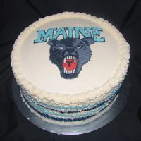 Maine Black Bears Cake This is all buttercream...free handed the image on after looking at the University's logo.