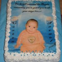 Christening Cake 2 Layer Carot Cake with Raisins and chopped Pecans, filled with Cinnamon Frosting. Edible Image and decorated with BC and Cake Glitter