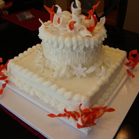 Fire And Ice Cake   Cake I donated for a charity dinner with a Fire and Ice Theme. Buttercream with fondant accents.