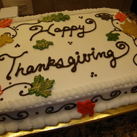 Happy Thanksgiving Made this cake for my husband's office potluck. Buttercream with fondant leaves dusted in gold.