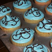 Cupcakes ...also to coordinate with the scroll work cake
