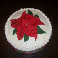 Pointsetta quickie cake for my cousin's christmas party...red velvet with creamcheese frosting, fondant pointsetta