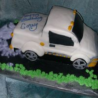 1St Truck Cake  Chocolate cake w/fudge &chocolate ganache filling. .The picture of a similer cake was given to me to copy. I learned a lot and will do...