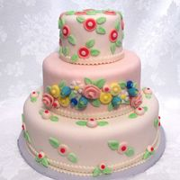Pink Fondant Covered With Stylized Fondant Flowers 3-tier fondant any occasion cake.